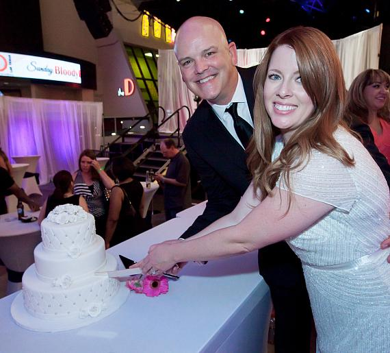 Chet Buchanan and Amy enjoy their wedding cake
