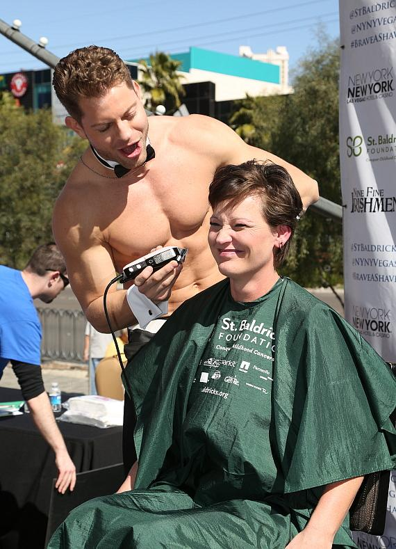 Chippendale Jaymes Vaughn shaves a woman's head at New York-New York's 6th annual St. Baldrick's Day