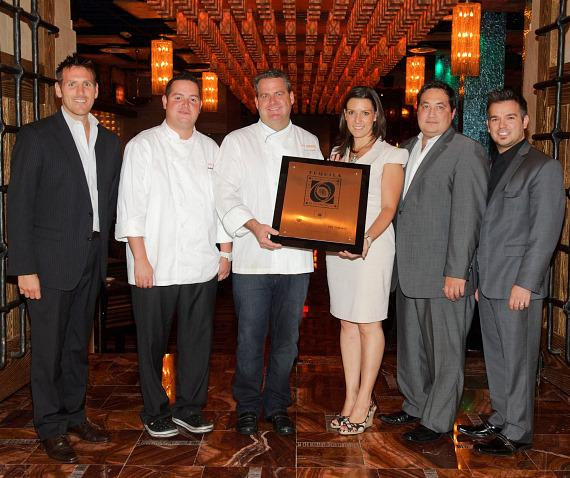 Chris Labarbera, Chef Roberto Hernandez, Chef Scott Linquist, Daniela Solis CRT, GM Tony Fisher and Rocco Gonzalez receive Award T plaque at Dos Caminos Las Vegas