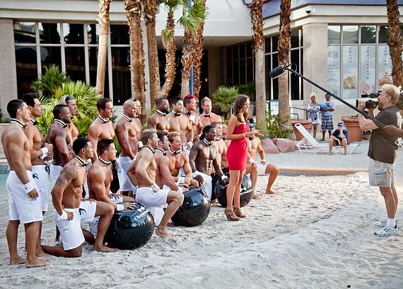 """Christina McLarty of THE INSIDER and the Men of Chippendales at the Rio pool. Tune in to THE INSIDER on Tuesday, August 19 for a """"behind-the-scenes"""" of the Chippendales calendar photo shoot"""