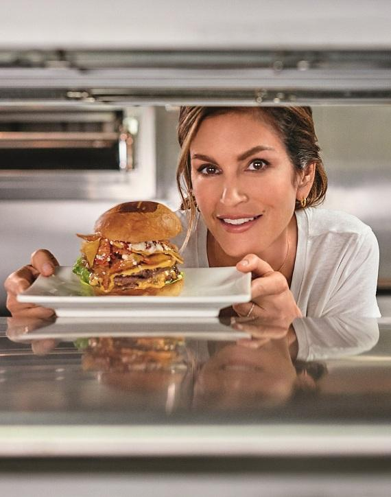 Cindy Crawford with Cindy's Casa Burger at Umami Burger