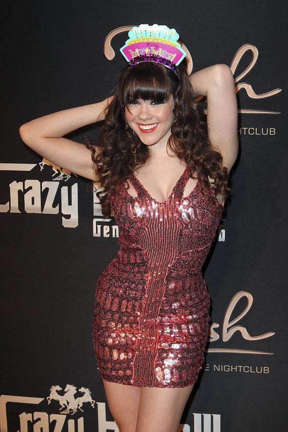 Claire Sinclair posing with tiara on red carpet