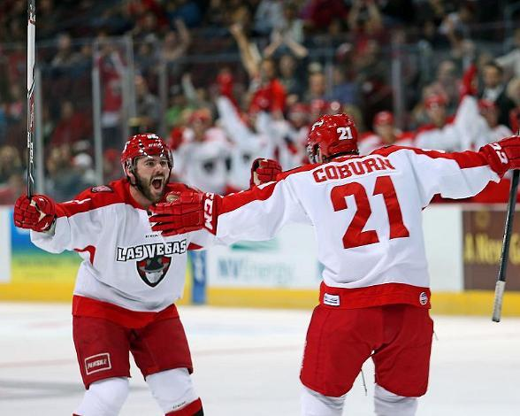 Wranglers (D) Eddie DelGrosso (left) helps (D) Greg Coburn celebrate the first goal of the game
