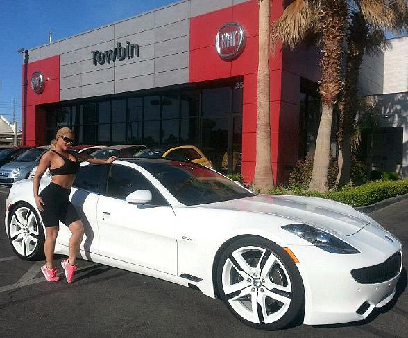 "Peepshow Star Nicole ""Coco"" Austin Buys Electric Sports Sedan from Towbin Automotive"