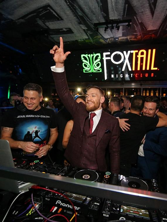 Conor McGregor takes over the DJ booth at the official UFC 194 after-party at SLS Las Vegas