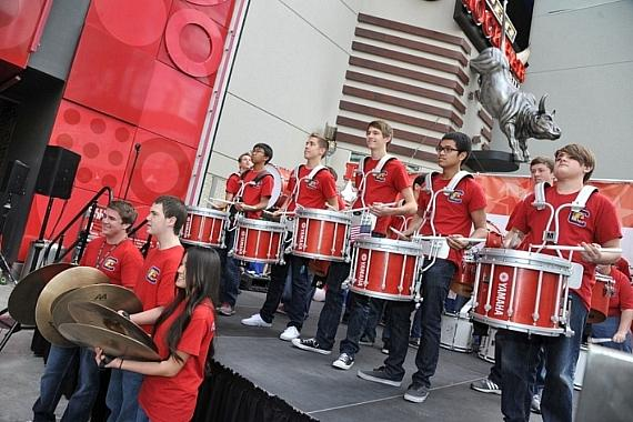 Coronado High School Drum Line performed on stage outside PBR Rock Bar at Miracle Mile Shops During USA Sevens Rugy Pep Rally for USA Eagles