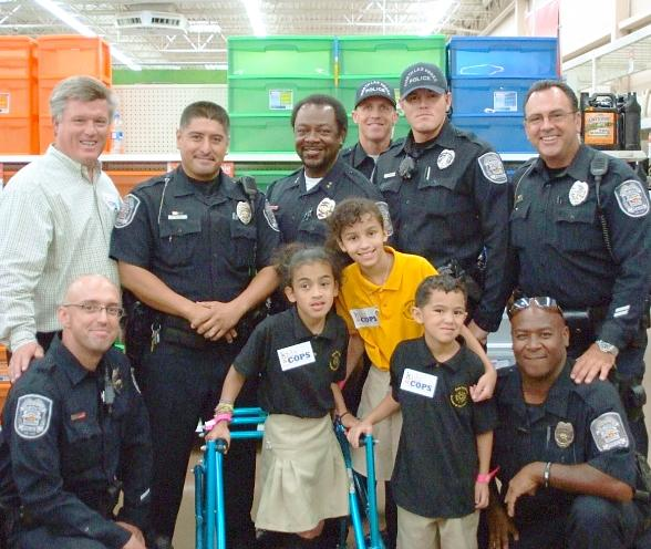 Councilman Robert L. Eliason, NLVPD officers meet students and take pictures at United Way's Kids & Cops event at Walmart