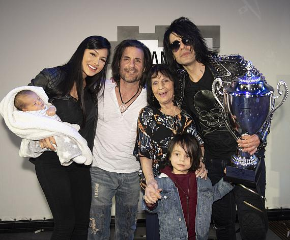 Criss Angel and family celebrate after the presentation of the VANISH G.O.A.T. Award, Feb. 22