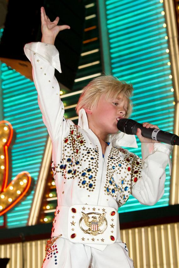 """Photo Cutline 2 Six year-old Gabriel """"The Storm"""" Jarrett performs at Fremont Street Experience during the Ultimate Elvis Weekend."""