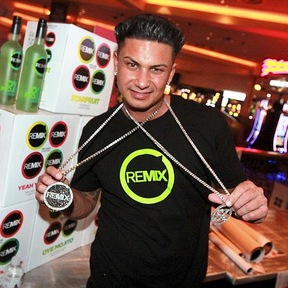 DJ Pauly D poses with his cocktail brand Remix