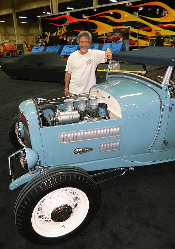 "Nick Kallos with ""The Contender"" 1929 Ford Model A Roadster at Barrett-Jackson"
