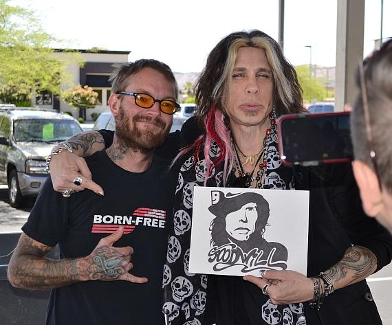 """Steven Tyler"" Tribute Artist Chris VanDahl of Legends in Concert posed with Goodwill donors in Las Vegas"