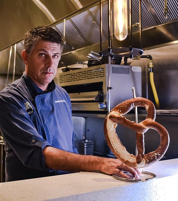 Executive Chef Damian McEvoy with German Soft Pretzel at The Smashed Pig Gastropub