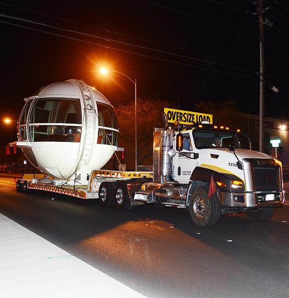 The first passenger cabin of the Las Vegas High Roller observation wheel is transferred to the wheel site early Monday, Nov. 4
