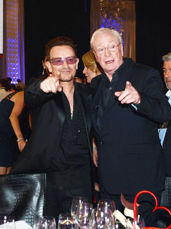 Singer Bono of U2 (L) and Sir Michael Caine