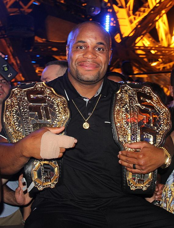 Daniel Cormier Poses with Championship Belts at Chateau