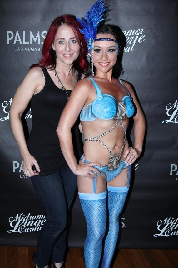 Danielle Harris poses with local body painter, Kelly Belmonte, at Midsummer Lingerie Masquerade bash at Palms Pool