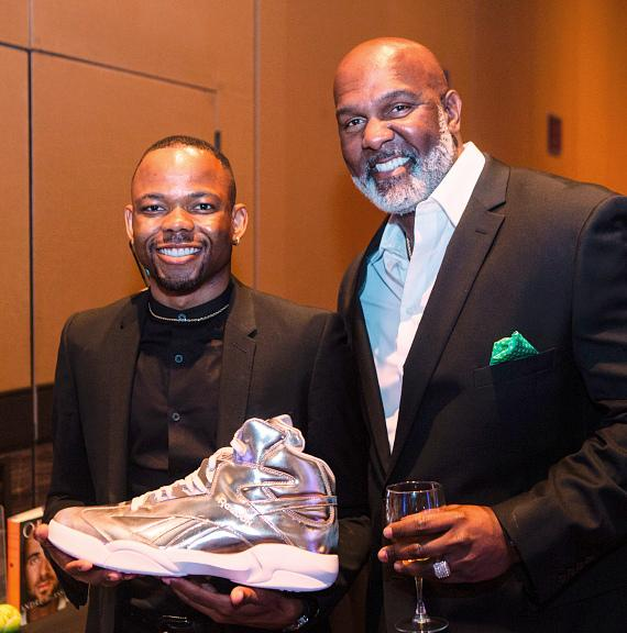 Darion Marquis & Keith Giles post with Shaquille O'Neal's size 22 shoe