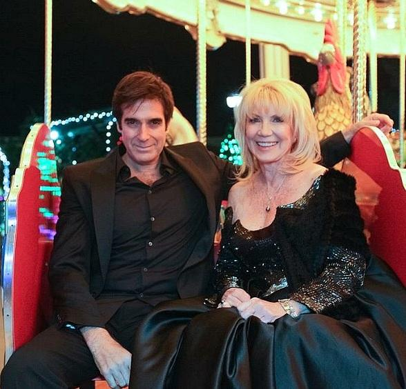 Illusionist David Copperfield and Associate Executive Director of Opportunity Village, Linda Smith, took a ride on Cheyenne's Enchanted Carousel at Opportunity Village's Magical Forest