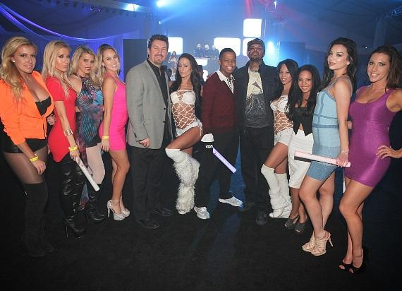 DJ Paul, his son Nautica, casino Executive Richard Wilk with GoGo dancers and models at DLVEC