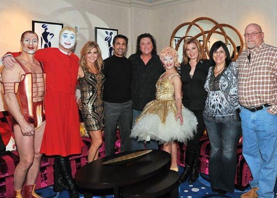 "Dot Jones of Glee enjoys a playful moment with one of ""O's"" signature artists, the ballerina, before enjoying the show with her wife and friends to celebrate her 50th birthday"