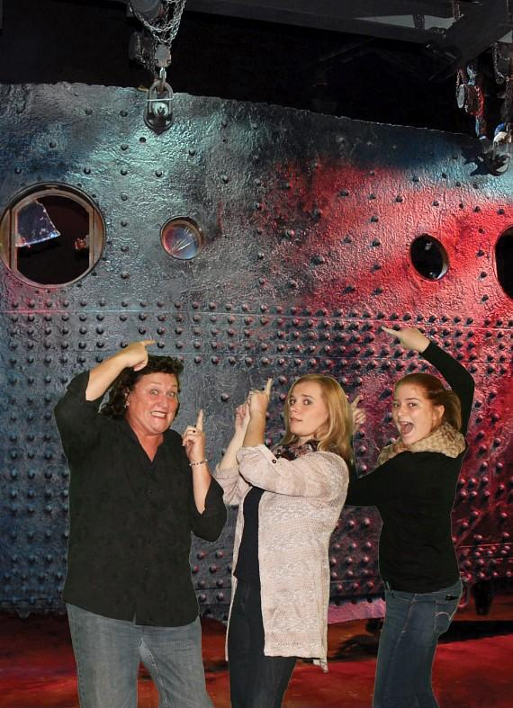 Dot-Marie Jones and family in front of The Big Piece at Titanic The Artifact Exhibition