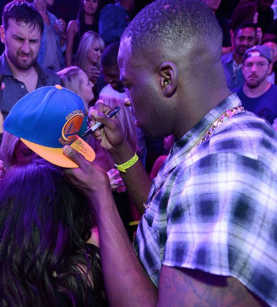 Draymond Green signs Golden State Warrior hat at Marquee