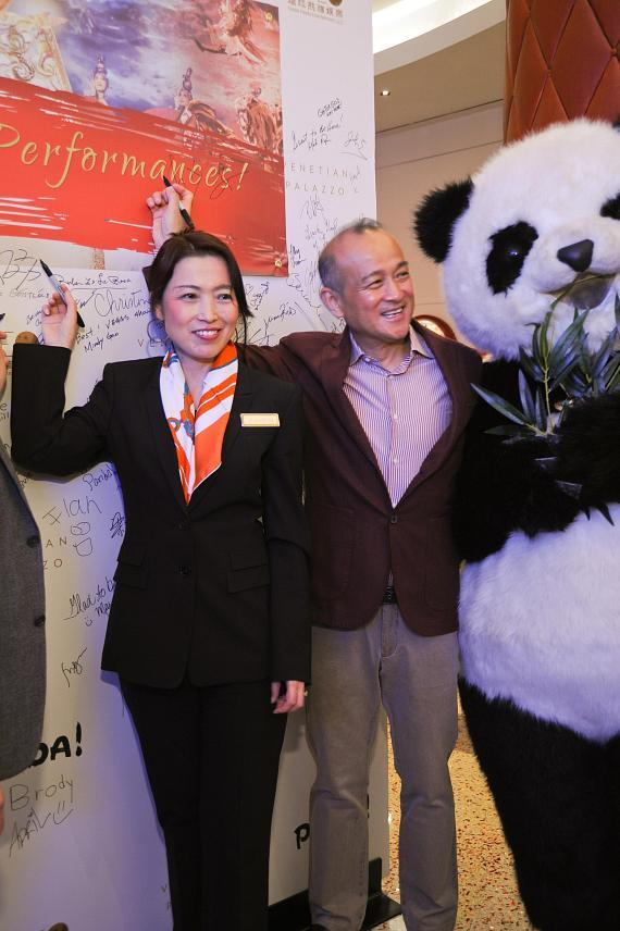 Elizabeth Hansen, Venetian Palazzo Director of Asian Leisure Marketing and PANDA! Director An Zhao Sign to Commemorate 100th PANDA! Show
