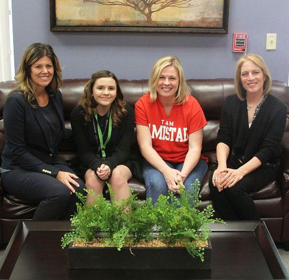 Enjoying new furniture - asst. principal Trisha Hathy, student Samantha Moon, teacher Dr. Audra Duvall and Linda Altewitz with Walker Furniture