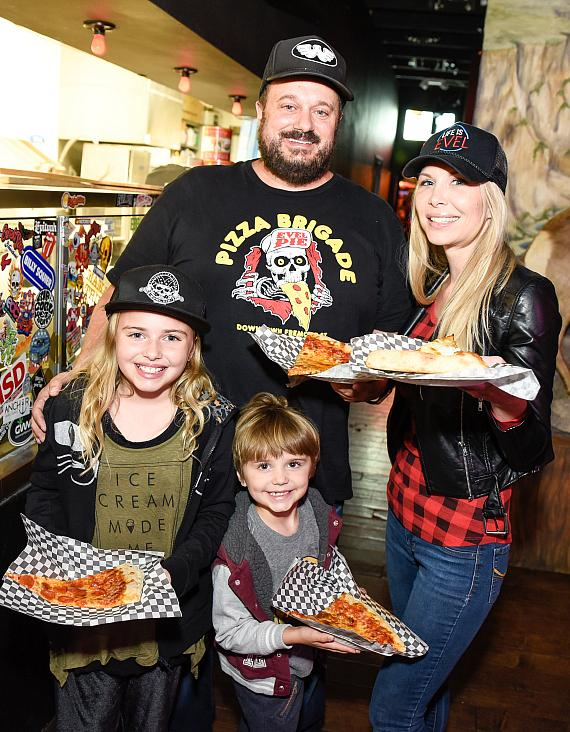 Evel Pie's Managing Partner Branden Powers celebrates with his family