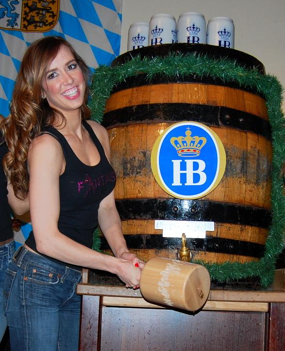 Mariah of FANTASY cracks open a barrel of beer at Hofbräuhaus Las Vegas