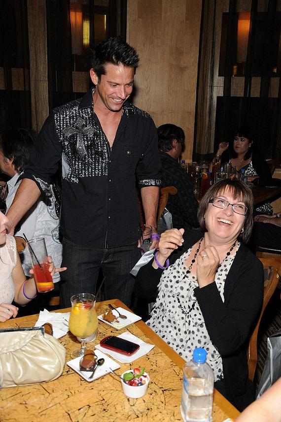 "Jeff Timmons with a guest at ""Ultimate FANTASY"" calendar party in Rice & Company at Luxor"