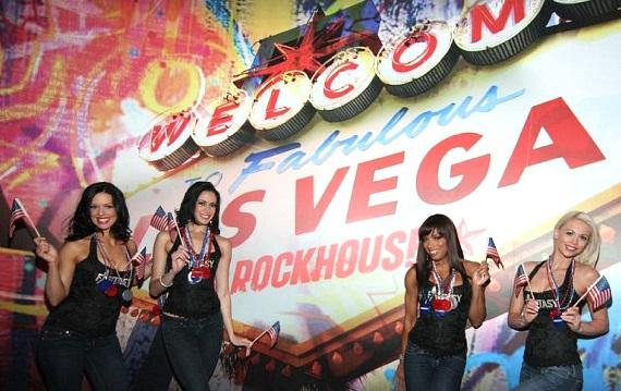 FANTASY ladies at the Vegas Rockhouse sign