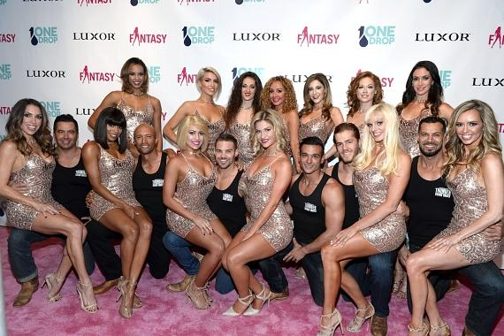 The Cast of FANTASY Poses with the Cast of Thunder From Down Under on the Pink Carpet