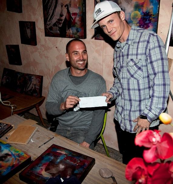 ey Vanas, Managing Partner of First Friday Las Vegas, handing over the check for the painting