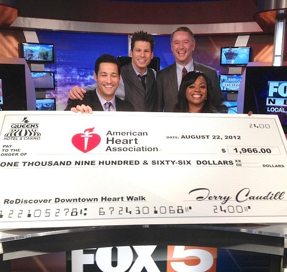 Mike Hammer Presents Four Queens Check for $1966 to American Heart Association