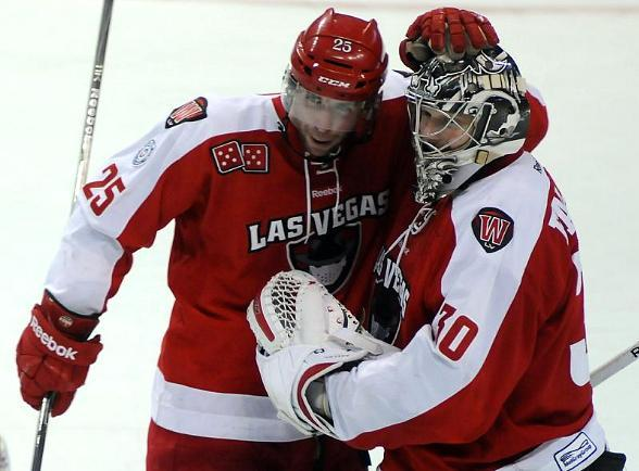 Wranglers forward Andrew Sarauer congratulates goaltender Joe Fallon on the shootout win over Alaska
