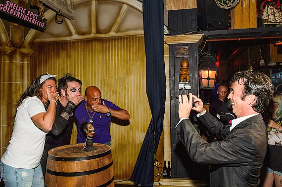 Fans posing for photos with Tape Face and his shrunken head