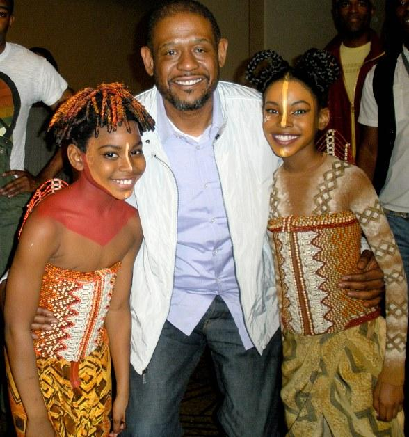 Forest Whitaker with Diamond White (Young Nala) and Aubrey Joseph (Young Simba).