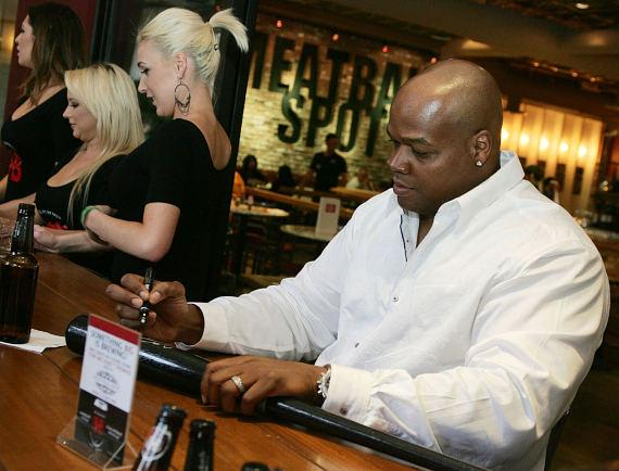 Frank Thomas signing memorabilia for fans on Meatball Spot's patio