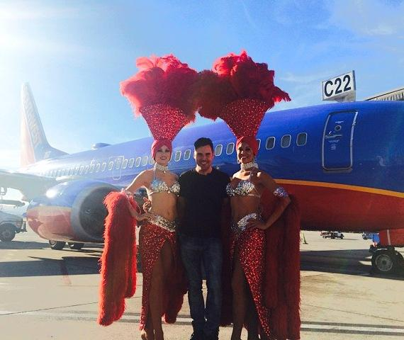 Frankie Moreno poses with Las Vegas showgirls at McCarran International Airport