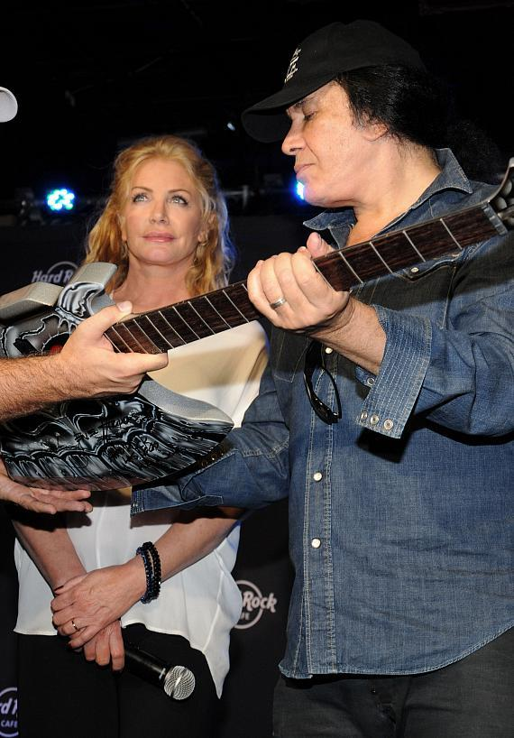 Shannon Tweed and Gene Simmons with guitar at Hard Rock Cafe
