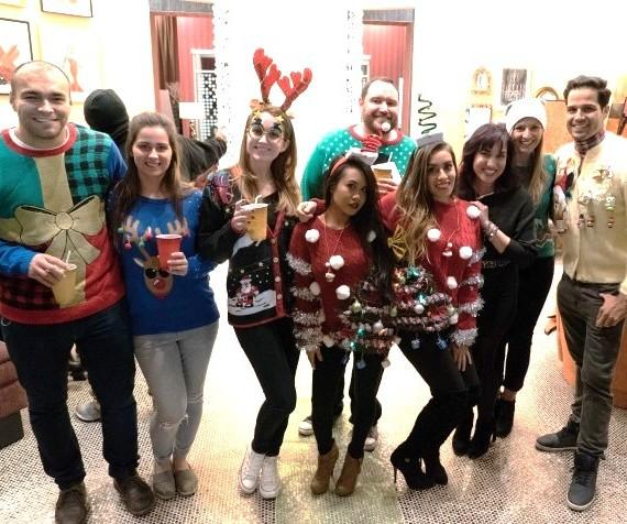 Ricardo Laguna, Aimee Montgomery and Laura Coronado with winners of Ugly Sweater Contest