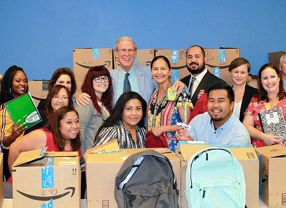Treasure Island Employees Donate 300 Backpacks with School Supplies