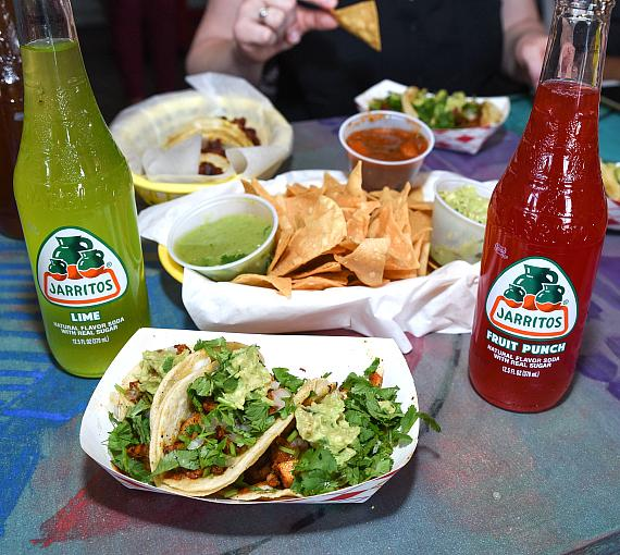 Guest enjoy a selection of Bomb Taco dishes and refreshments