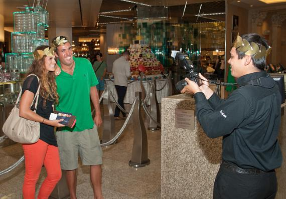 Guests at Bacchanal Buffet wearing Roman laurel wreaths and taking photos