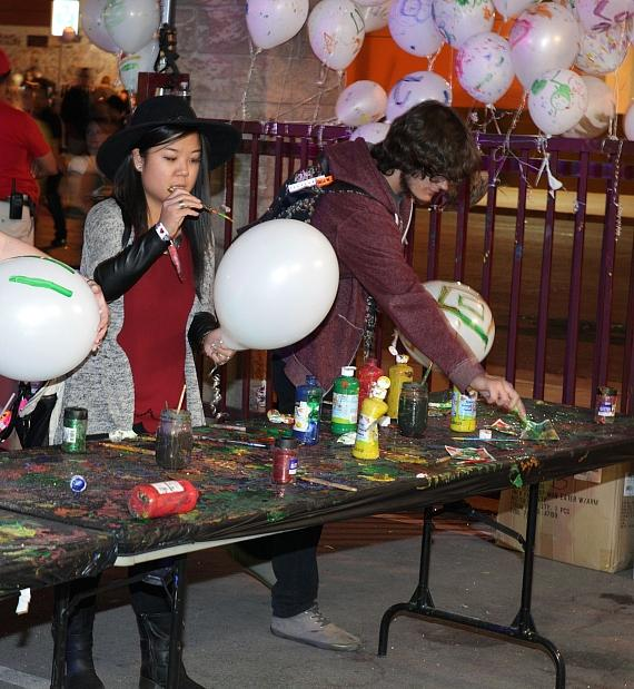 Guests decorate balloons at INSPIRED by the D at Life Is Beautiful Festival, Las Vegas
