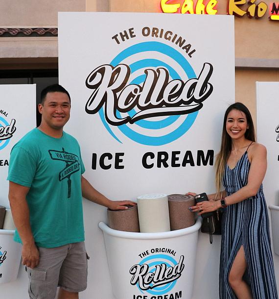 Guests pose in front of Rolled Ice Cream sign