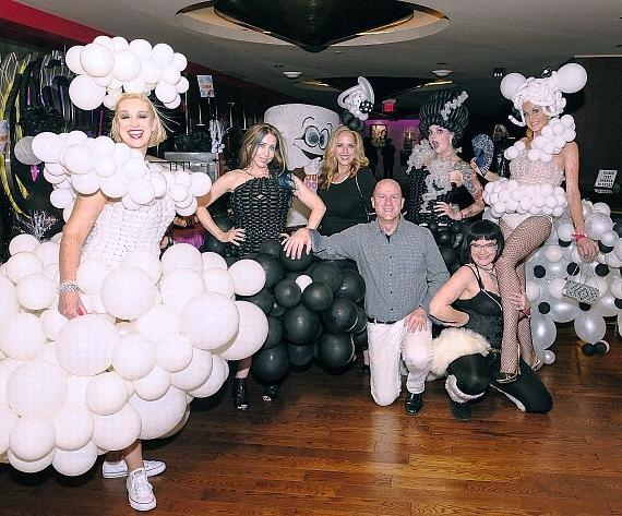 Guests wear balloon dresses to the Black & White party