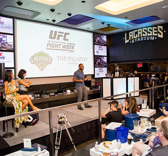 Rashad Evans performs at the UFC Lip Sync Challenge at Lagasse's Stadium as the crowd looks on